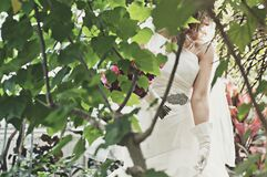 Bride in green garden Royalty Free Stock Photography