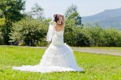 Bride at green grass Stock Photos