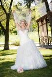 Bride on a green grass Stock Photos