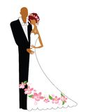 Bride and groom. Bride has flowers in her hair and on her dress Stock Photography