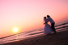 Bride and groom. Hugging on the beach Stock Photography