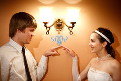 Bride and groom. Groom and bride near the lamp Royalty Free Stock Images