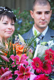 Bride and groom. Smiling bride and groom portrait with flowers Royalty Free Stock Images