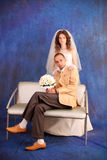 Bride and groom. Over blue studio background Stock Image