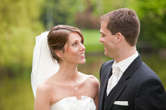 Bride and groom. Beautiful bride and groom looking eachother happily in the eyes Royalty Free Stock Photos