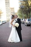 Bride and Groom. Vertical image of a bride and groom kissing on their wedding day stock image
