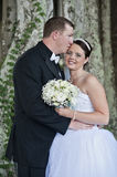 Bride and Groom. A groom kissing brides forehead outside. Wedding couple Royalty Free Stock Image