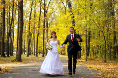 Bride and Groom. Running in a park stock image