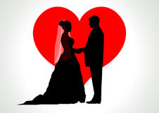 Bride and Groom. Silhouette illustration of a bride and groom with heart symbol as the background Royalty Free Stock Image
