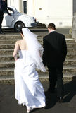 Bride and Groom. Walking towards car Stock Images