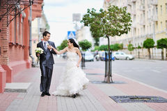 Bride and groom. Having fun in an old town stock photography