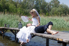 Bride and groom. On the wooden bridge Royalty Free Stock Photo