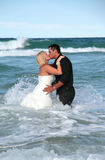 Bride and Groom 5. Bride and groom share a kiss in the ocean during a Trash the Dress session stock photos