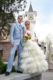Bride and groom. Standing on porch looking at viewer and smiling Royalty Free Stock Photo