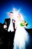 Bride and Groom. Against the Sun stock photography
