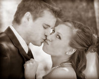 Bride and groom. A romantic couple kissing outside Royalty Free Stock Images
