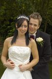 Bride and Groom. In affectionate embrace, UK Royalty Free Stock Photography
