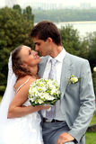 Bride and groom. Young happy newlyweds couple outdoors stock photography