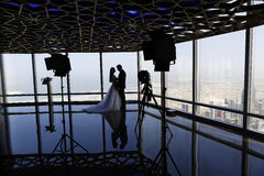 Bride and groom above Dubai cityscape Stock Images