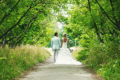 The bride and groom in the alley Royalty Free Stock Photography