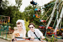 Bride and groom in amusement park Royalty Free Stock Photo