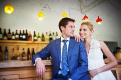 Bride and groom around the bar Royalty Free Stock Images