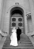 Bride and groom ascend stairs Stock Image
