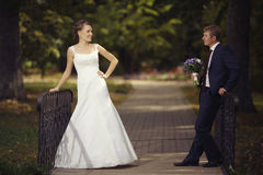 Bride and groom at autumn park Stock Image