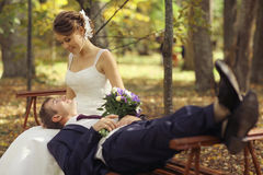 Bride and groom in autumn park Stock Photography