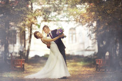 Bride and groom in autumn park Royalty Free Stock Photography
