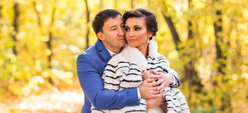 Bride and groom in autumn park Love Life.  royalty free stock image