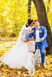 Bride and groom in autumn park Love Life.  stock photo