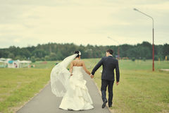 Bride and groom away Royalty Free Stock Images