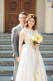 Bride and groom on the background of beautiful church.  old building. Arch. Wedding Stock Photo