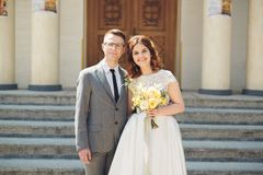 Bride and groom on the background of beautiful church.  old building. Arch. Wedding Royalty Free Stock Photo
