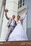 Bride and the groom on a background of a building Royalty Free Stock Photo