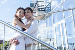 Bride and groom  on  background of the glass Stock Image