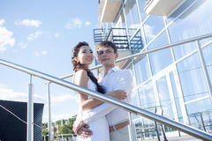 Bride and groom  on  background of the glass Stock Photography