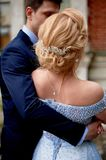 Bride and groom on the background of an old estate. Classical wedding. Wedding walk and photo shoot. Embraces stock image