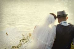 Bride and groom on the background of water Royalty Free Stock Photography