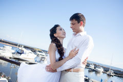 Bride and groom on the background of  yacht club Stock Photo