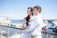 Bride and groom on the background of  yacht club Royalty Free Stock Photo