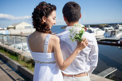 Bride and groom on background of  yacht club Stock Image