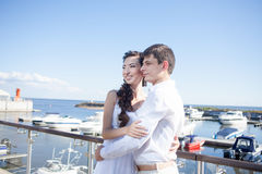 Bride and groom on the background of  yacht club Stock Photography