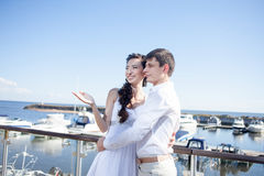 Bride and groom on the background of  yacht club Royalty Free Stock Photos