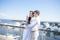 Bride and groom on the background of  yacht club Royalty Free Stock Photography