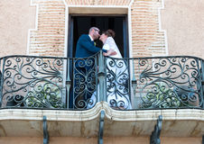 Bride and Groom on a balcony Stock Photos