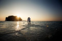 Bride and groom barefoot at spit Royalty Free Stock Images