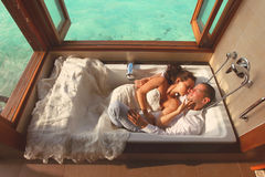 Bride and groom in bath tub in Maldives. Love royalty free stock images
