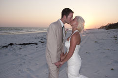 Bride and Groom at the Beach Royalty Free Stock Images